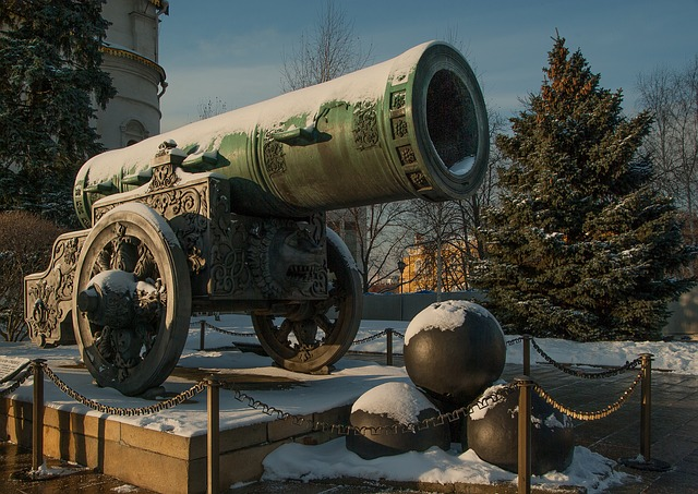Image of a large, ornate cannon, half-covered in snow, on a pedestal, with a small pile of very large cannonballs in front of it. This is a representation of overkill per the Therapeutic Order, if a lesser force is needed.